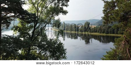 Bend In The River With Trees In The Foreground