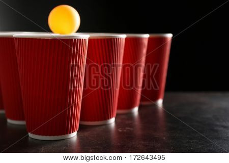 Plastic beer pong cups and ball, closeup