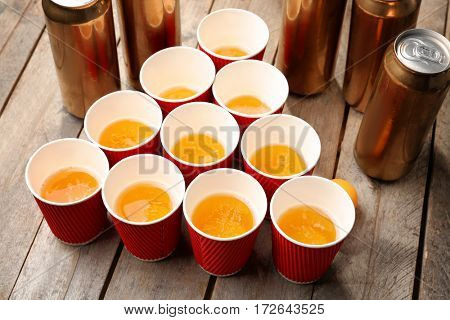 Plastic beer pong cups and cans on table, closeup