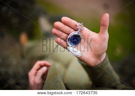 Man in suit looking at his pocket watch. The concept of expectations.