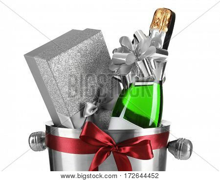Champagne bottle and gift box in bucket on white background