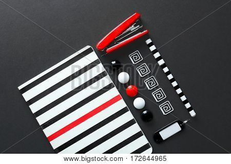 Flat lay of stationery on black background