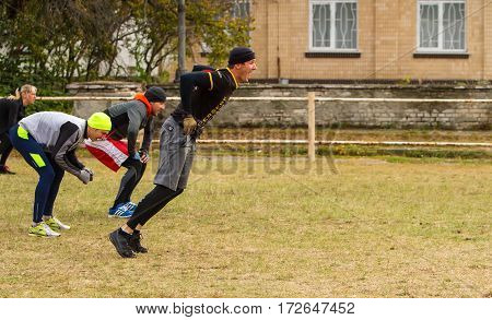 Kiev Ukraine - October 08. 2016. Street workout CrossFit training. The man in the initial phase of emotional long jump.
