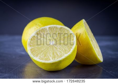 Lemons And Limes On A Gray Background