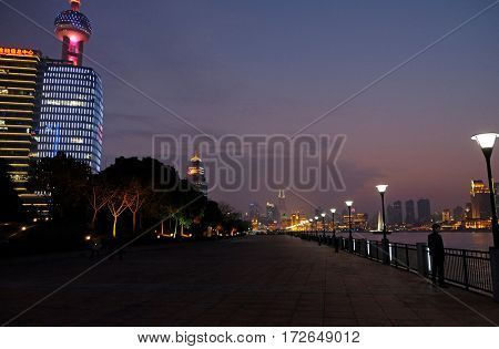 SHANGHAI - FEBRUARY 26: Night view to the riverside business center in Shanghai, China, February 26, 2016.
