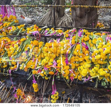 Background of Marigold garlands for worship at the temple