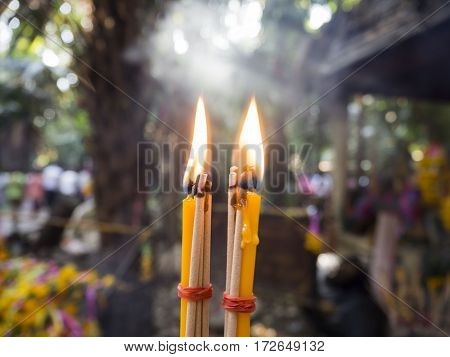 Candle worship Buddha in the temple Thailand