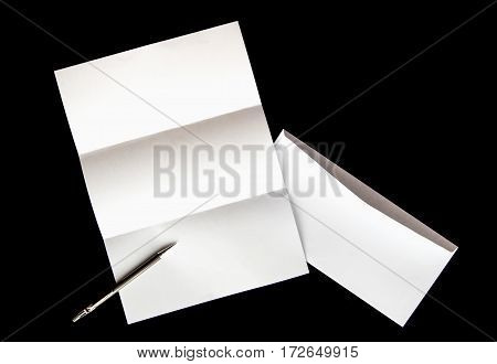 blank of letter paper and white envelope with pen Isolated on black background