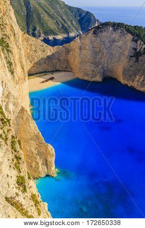 Navagio beach at sunny day, Zakynthos island, Greece