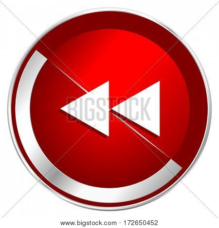 Rewind red web icon. Metal shine silver chrome border round button isolated on white background. Circle modern design abstract sign for smartphone applications.