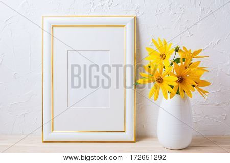 Gold decorated frame mockup with yellow rosinweed flowers. Empty frame mock up for presentation artwork.