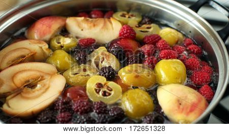 Compote Of Apples, Raspberries, Blackberries And Plums Cooked In Pan