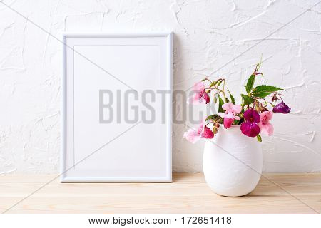White frame mockup with house plants in flowerpot. Empty frame mock up for presentation design.