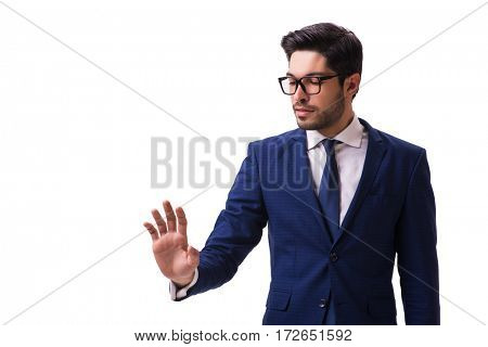 Young businessman pressing virtual buttons isolated on white
