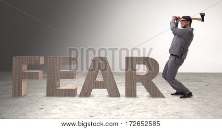 Angry man with axe axing the word fear