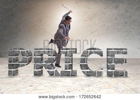 Angry man with baseball bat hitting price word