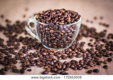 Cup With Coffee Beans On A Wooden Background