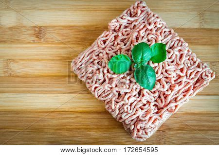 Minced Meat On A Wooden Background