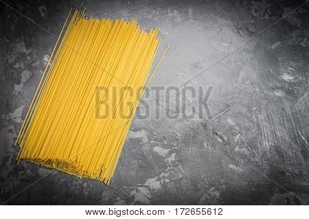 Uncooked Spaghetti On A Gray Background