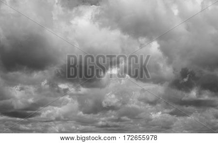 Clouds flying over horizon cloudscape. Gray cloudy sky.