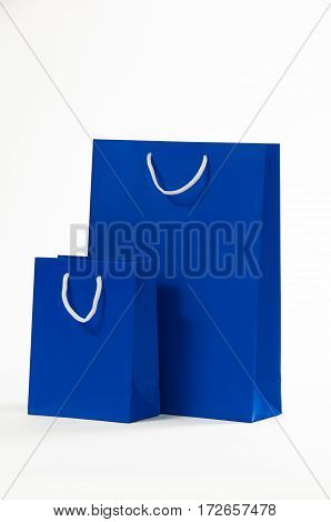 Two blue paper bag isolated on white background