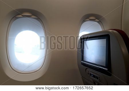 Airplane window seats with entertainment display screen