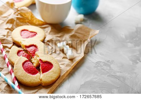 Cookies with parchment on grunge background, closeup