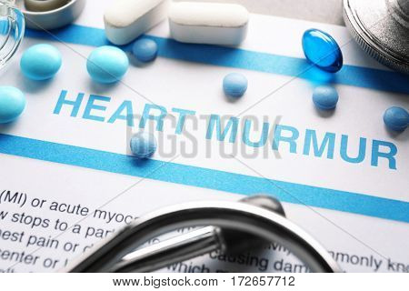 Diagnosis HEART MURMUR on medical report and medicines closeup