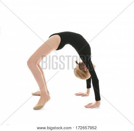 Young girl doing gymnastic exercise, isolated on white