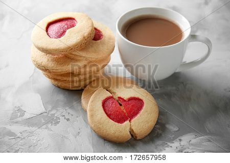 Cookies with coffee on grunge background, closeup