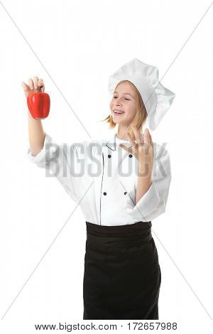 Cute girl in chef uniform on white background