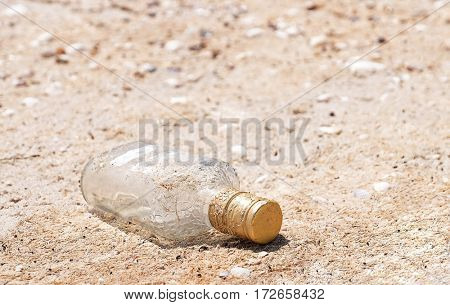 Polluted with glass bottle sand shore