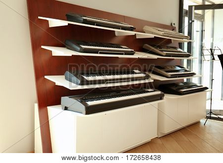 Synthesizers on shelves in music shop