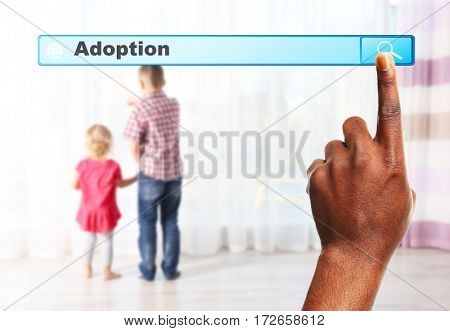 Adoption concept. Male hand pushing on search box