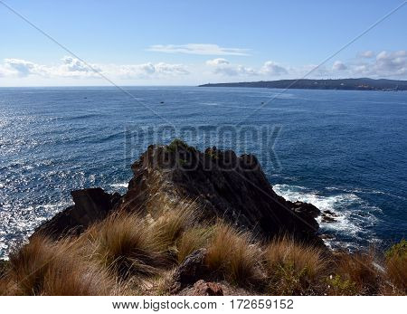 View from Rotary Park Lookout to Twofold Bay in Eden. Hills and rugged coastline NSW Australia. Rocky coastline of Eden NSW Australia.