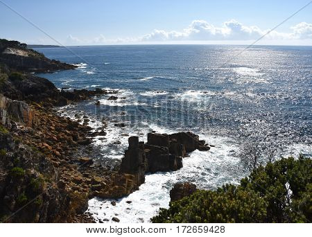 View from Rotary Park Lookout to Twofold Bay in Eden. Hills and rugged coastline NSW Australia. Rocky coastline of Eden NSW Australia. poster