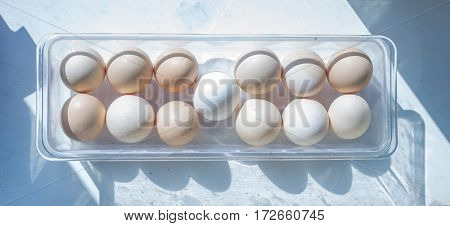 Eggs In A Plastic Tray On White. Easter Eggs.