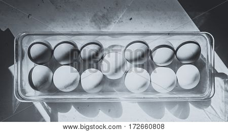 Eggs In A Plastic Tray On White. Easter Eggs. Black And White Style.
