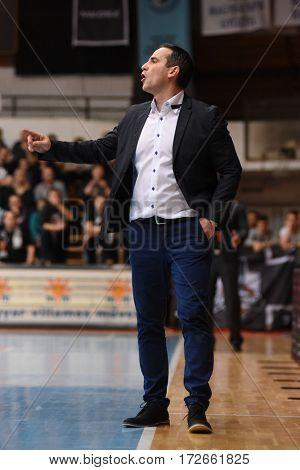 KAPOSVAR, HUNGARY - FEBRUARY 4: Adam Fekete (Kaposvar trainer) in action at Hungarian Championship basketball game with Kaposvar (white) vs. Pecsi VSK (black) on February 4, 2017 in Kaposvar, Hungary.