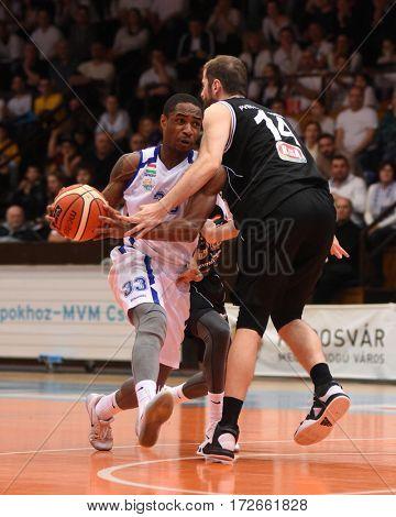 KAPOSVAR, HUNGARY - FEBRUARY 4: Jaytornah Wisseh (wihte 33) in action at Hungarian Championship basketball game with Kaposvar (white) vs. Pecsi VSK (black) on February 4, 2017 in Kaposvar, Hungary.