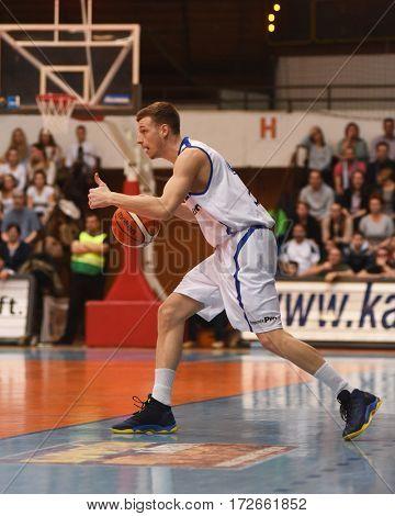 KAPOSVAR, HUNGARY - FEBRUARY 4: Peter Papp (in white) in action at Hungarian Championship basketball game with Kaposvar (white) vs. Pecsi VSK (black) on February 4, 2017 in Kaposvar, Hungary.