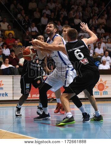 KAPOSVAR, HUNGARY - FEBRUARY 4: Peter Grebenar (in white) in action at Hungarian Championship basketball game with Kaposvar (white) vs. Pecsi VSK (black) on February 4, 2017 in Kaposvar, Hungary.