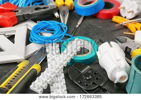 Different electrician tools on table, closeup
