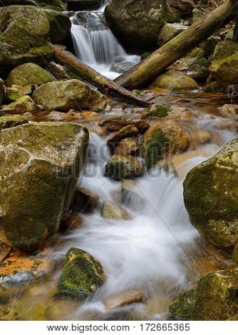 Waterfall and cascade on a mountain creek