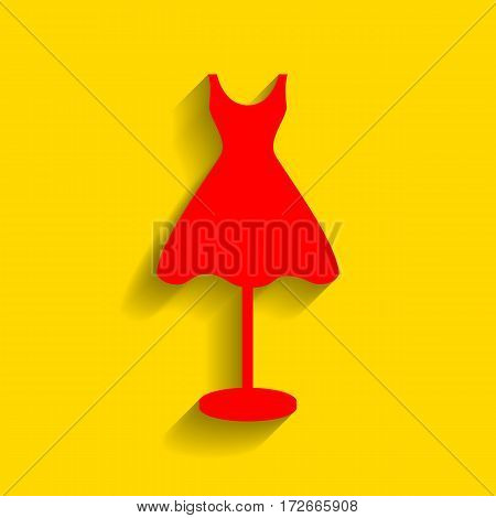 Mannequin with dress sign. Vector. Red icon with soft shadow on golden background.