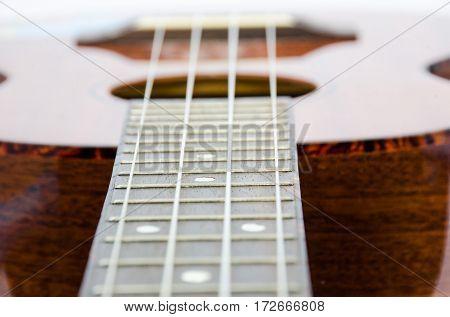 guitar ukulele acoustic music instrument background on white