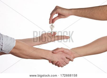 Buying a new house concept a women and man hand holding a model home and a key put together on isolate white background.