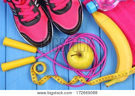 Pair Of Pink Sport Shoes, Fresh Fruits And Accessories For Fitness On Blue Boards