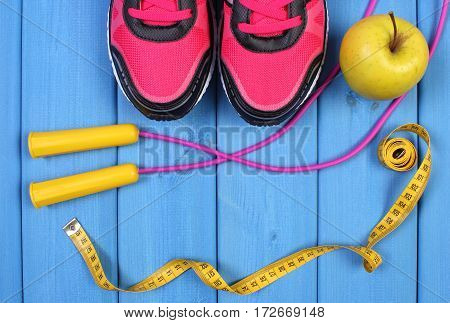 Pair Of Sport Shoes, Fresh Apple And Accessories For Fitness On Blue Boards, Copy Space For Text