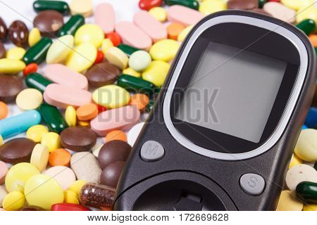 Glucose Meter With Heap Of Medical Pills And Capsules, Diabetes, Health Care Concept